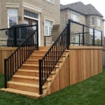 12.1 - Cedar closed steps, glass/aluminum railing.jpg